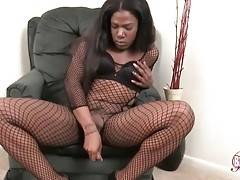 Attractive ebony she-male gives hand to her eager dong.